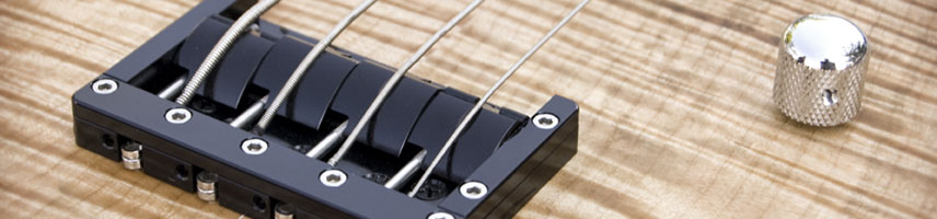 KSM Bass Bridge mounted to a quilted maple custom bass guitar